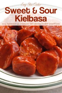 Slow cooker sweet and sour kielbasa on white serving plate.
