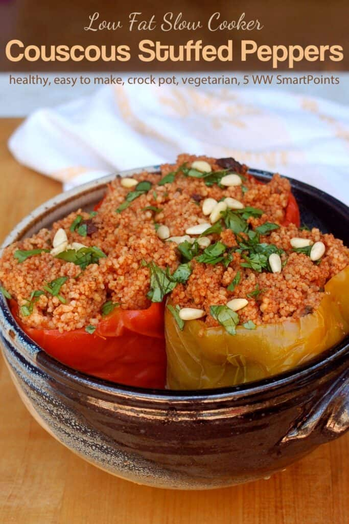 Three slow cooker couscous stuffed peppers in blue ceramic dish.