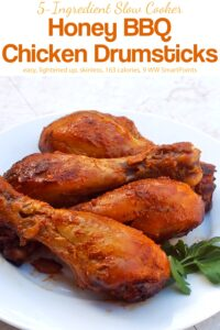 Skinless Honey BBQ Chicken Drumsticks on white plate.