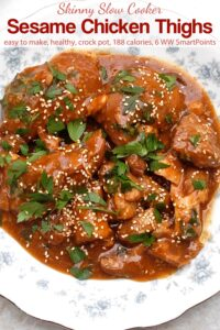 Sesame chicken thighs garnished with fresh cilantro in serving bowl.