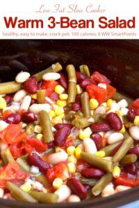 Crock pot with warm 3-bean salad.