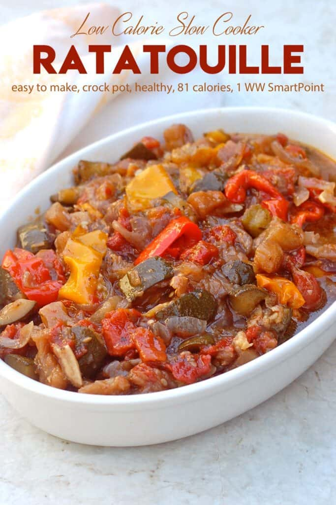 Ratatouille with eggplant, zucchini, peppers, onions and tomatoes in white serving dish