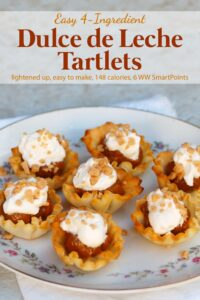 Easy 4-ingredient dulce de leche tartlets garnished with whipped topping and Heath bits.