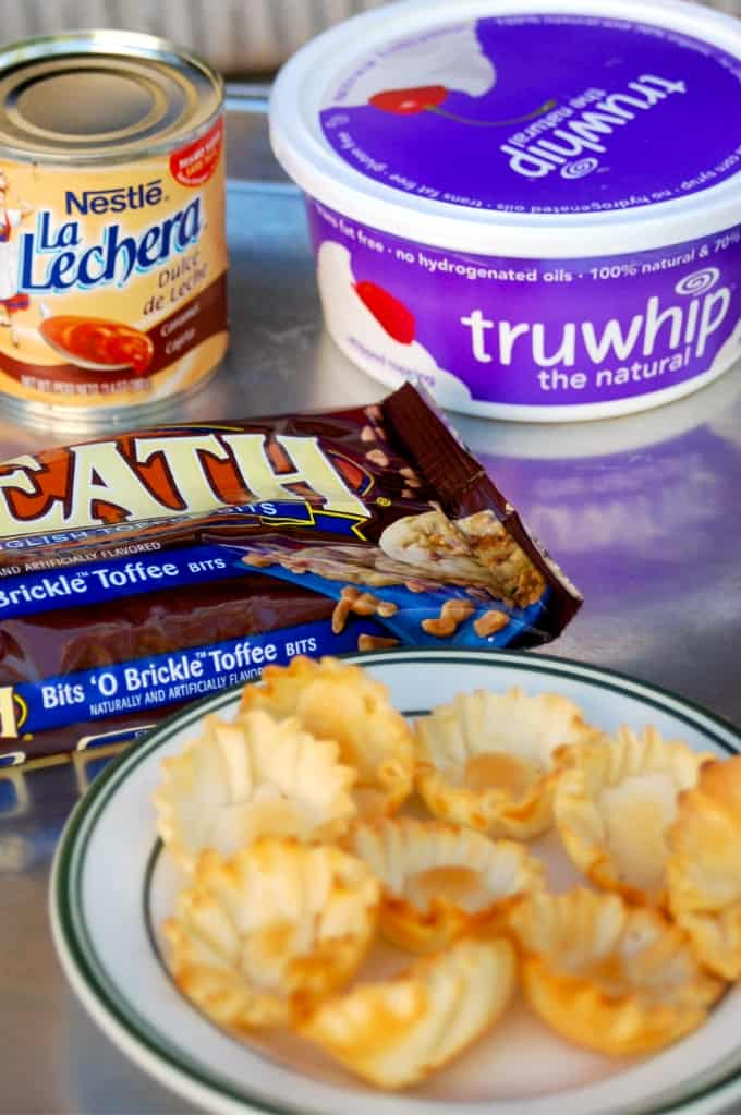Can of Nestle La Lechera, Truwhip whipped topping, Heath bits and mini filo shells for making 4-ingredient dulce de leche tartlets.