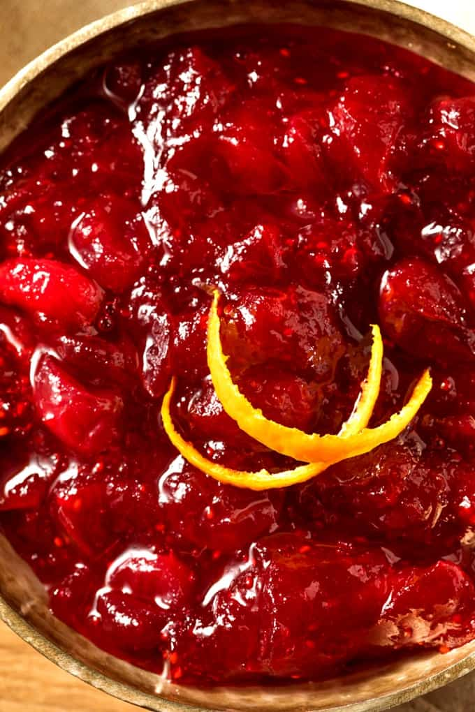 Apple Raspberry Cranberry Sauce garnished with sliced orange peel