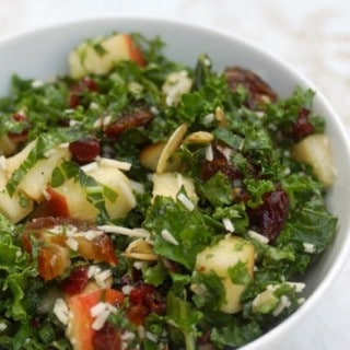 kale salad with apple and dates white deep bowl from above