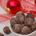 Weight Watchers No Bake Peanut Buttery Cookie Dough Balls arranged in a bowl with red ribbon christmas balls background