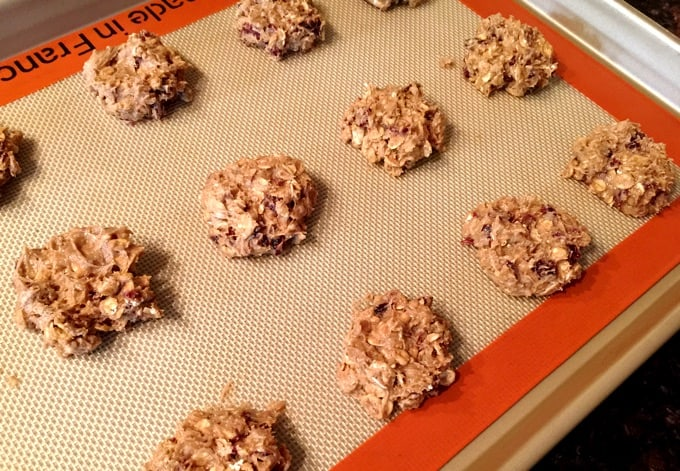 Cranberry ginger oatmeal cookies on silpat on cookie sheet