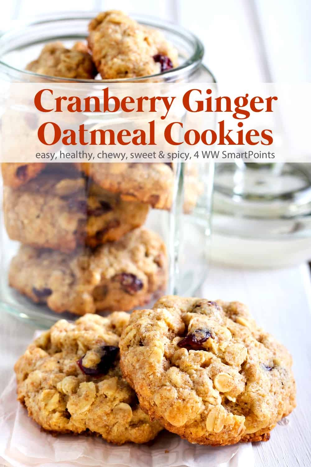 A moist and chewy low-fat cookie with the perfect combination of sweet and spice perfect for the holidays - these Cranberry Ginger Oatmeal Cookies have just 4 WW Freestyle SmartPoints each! #cranberrygingeroatmealcookies #oatmealcookies #cookies