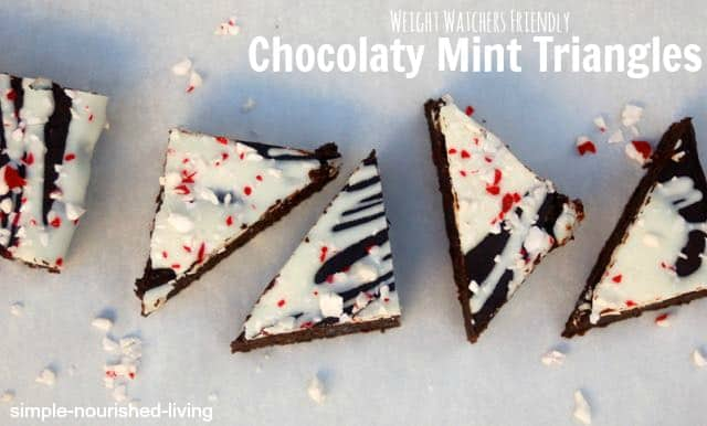 Weight Watchers Chocolate Mint Triangle Bars topped with Icing and Crushed Candy Canes arranged on white board from above