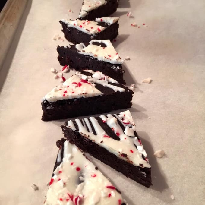 Peppermint Chocolate Brownie Triangles Topped with Icing and Crushed Candy Canes