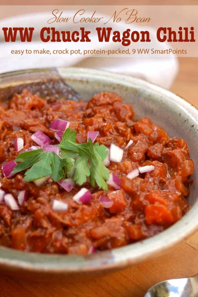 Bowl of chuck wagon chili without beans topped with chopped red onion and cilantro.