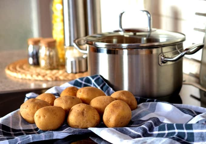 Uncooked potatoes and stock pot