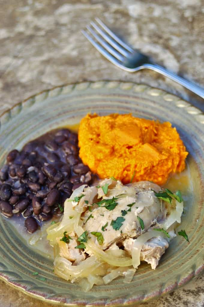 Slow Cooker Cuban Citrus Chicken with black beans and mashed sweet potatoes on dinner plate