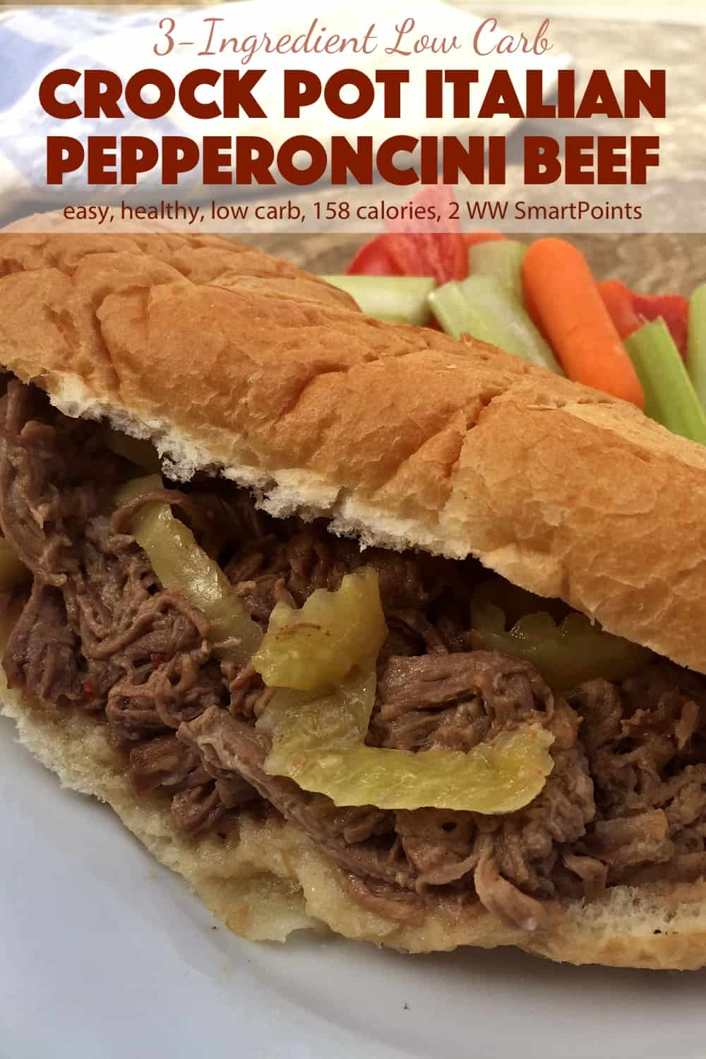 Shredded Italian pepperoncini beef in a sandwich roll with vegetable sticks