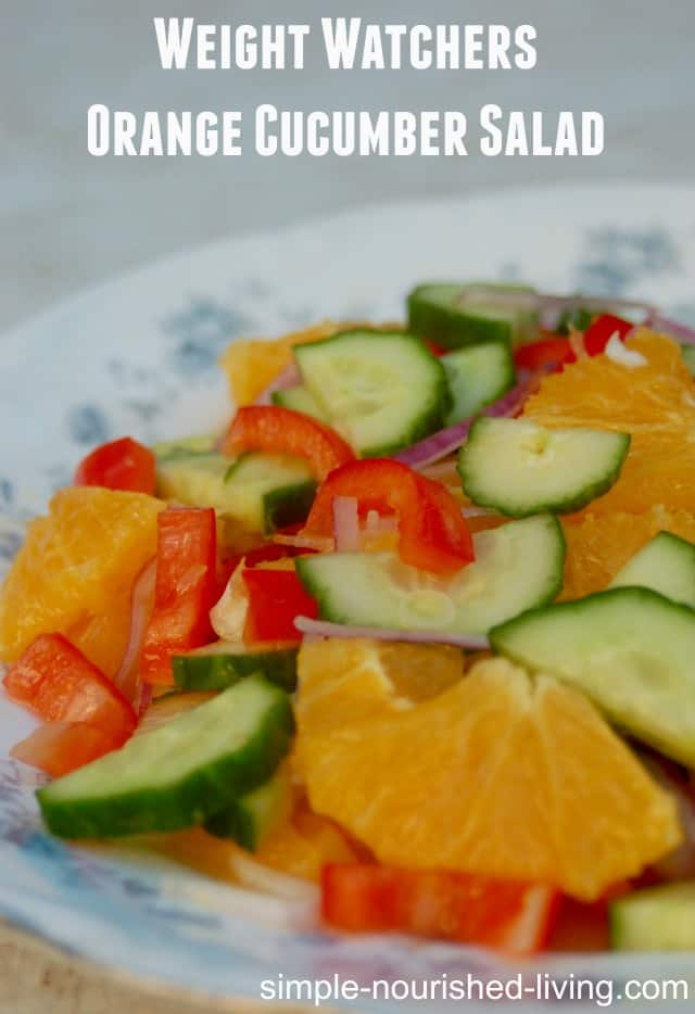 Orange Cucumber Salad with red bell peppers and onions on serving platter