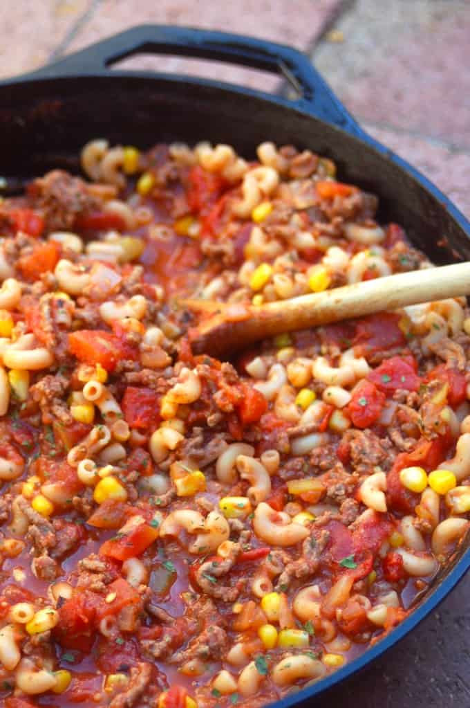 Skinny Southwestern Goulash in a skillet with wooden serving spoon