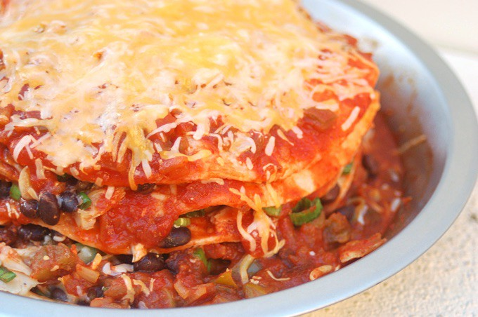 Stacked Chicken Enchiladas topped with cheese