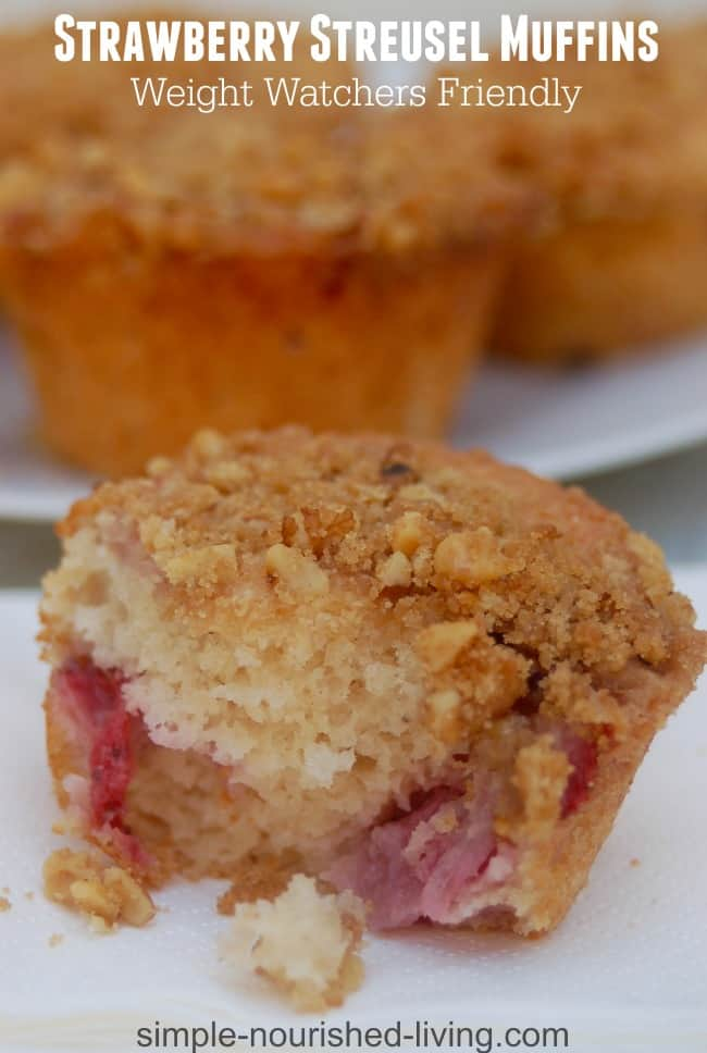 Strawberry Streusel Muffin Close UP with plate of muffins behind