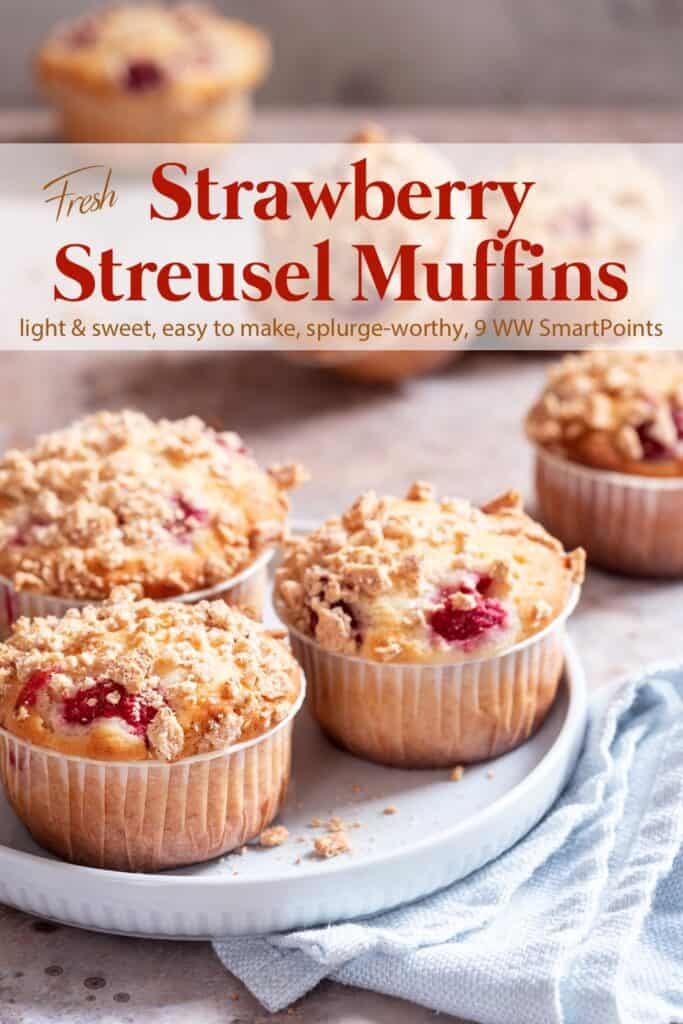 Strawberry streusel muffins on light blue plate