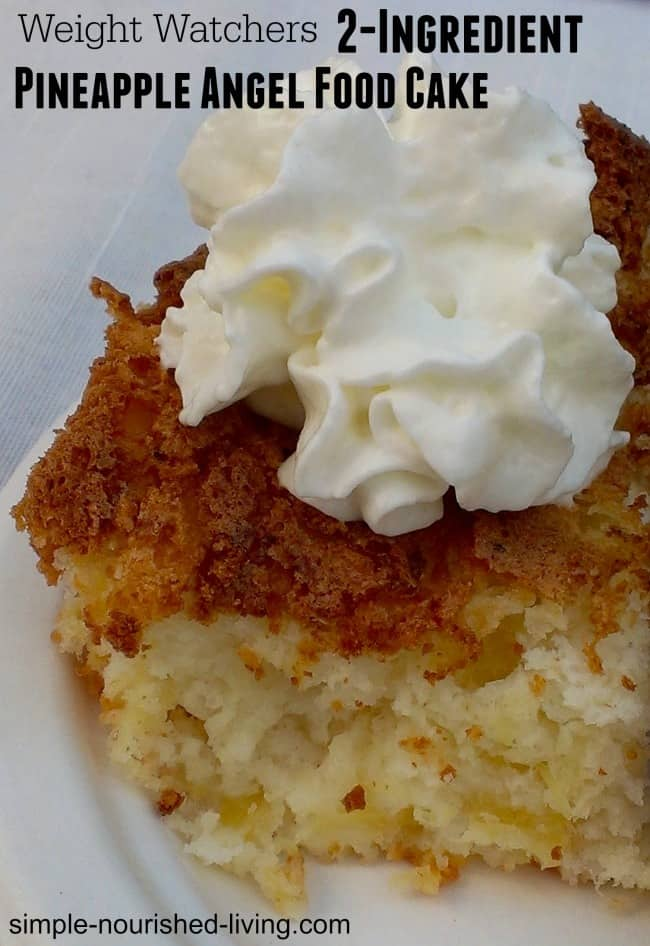 Slice of 2-ingredient pineapple angel food cake topped with whipped cream