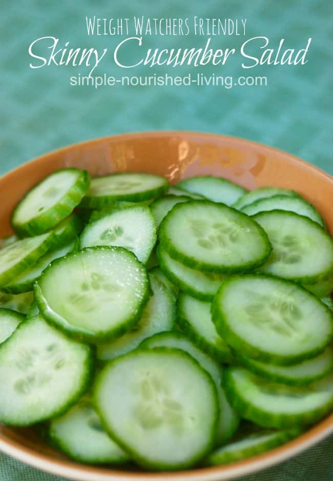 Sliced cucumber salad in brown bowl.