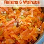 Shredded carrot salad with walnuts and raisins up close
