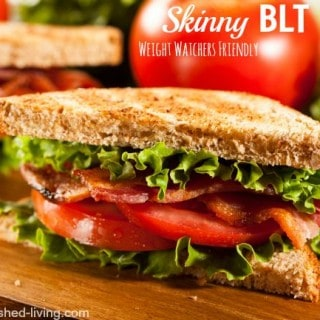closeup of blt on toast with tomato in backgroud