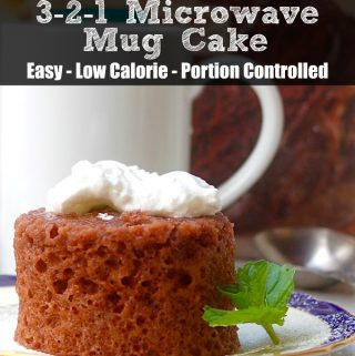 Easy Low Calorie 321 Microwave Mug Cake on a Plate with Whipped Topping and Sprig of Mint with White Mug in Background