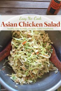 Tossing Asian Chicken Salad in stainless steel bowl.