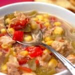 Bowl of Southwest chicken soup with green chilies and a spoon