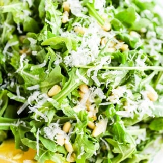 Simple Arugula Salad with Sunflower Seeds and Parmesan close up from above