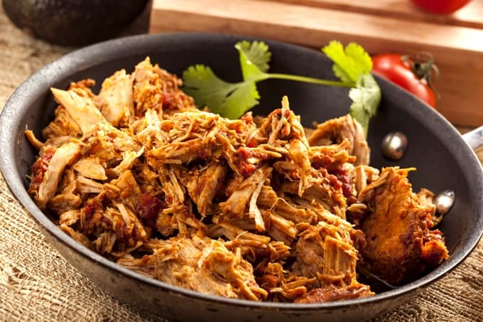 Shredded Chicken with Salsa in a pan with fresh cilantro