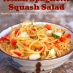 Asian spaghetti squash salad with cucumbers and red bell peppers in ceramic bowl.