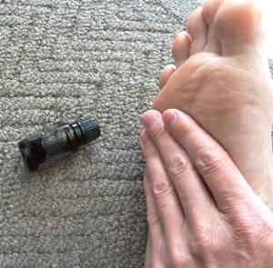 applying-essential-oil-on-feet
