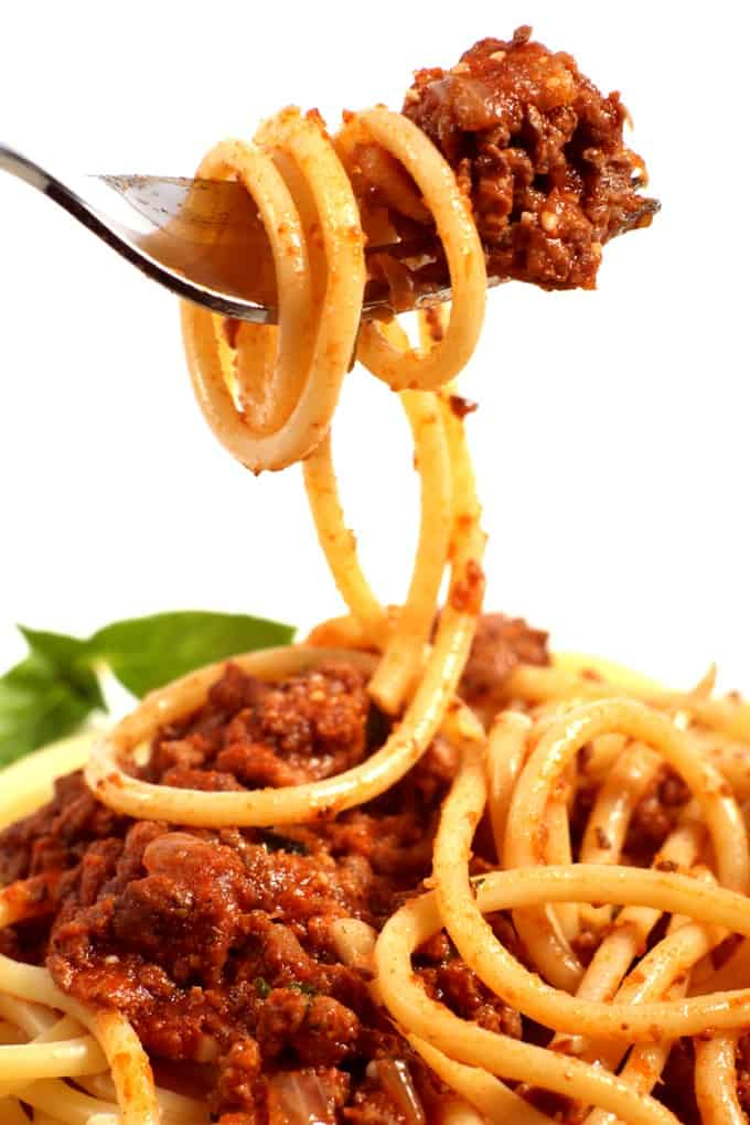 Spaghetti with meat sauce wrapped around a fork
