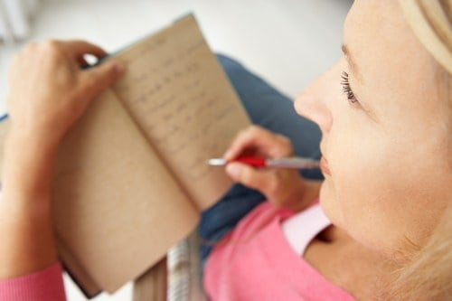 woman writing in journal 7 secrets weight loss success