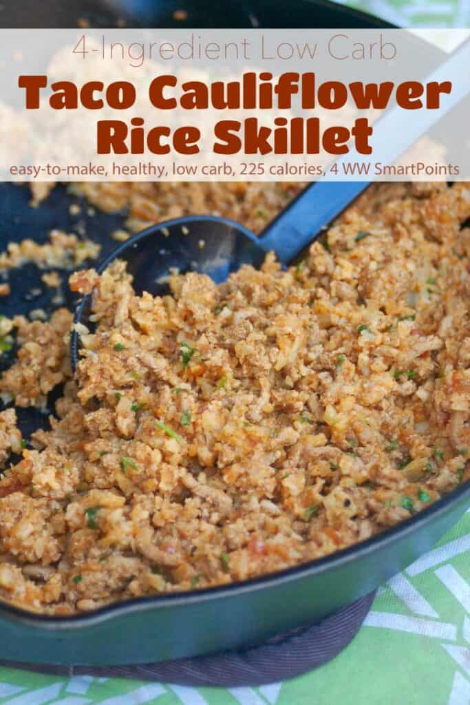 Taco Cauliflower Rice in skillet with serving spoon