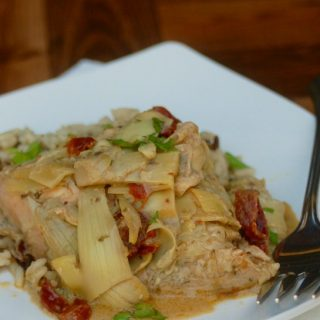 Slow Cooker Goddess Chicken Artichokes Sundried Tomatoes Weight Watchers in square white plate with fork