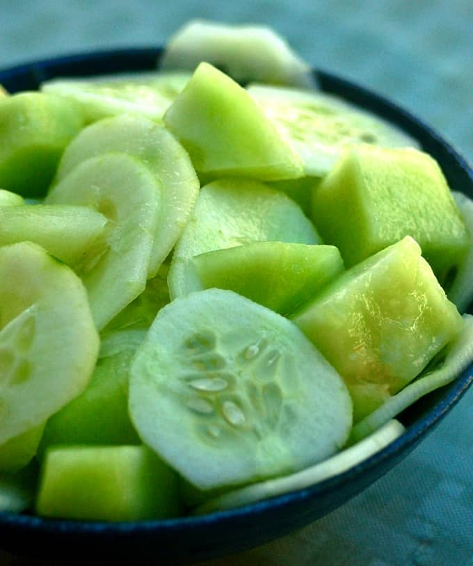 Honeydew Melon and Cucumber Salad in blue bowl.