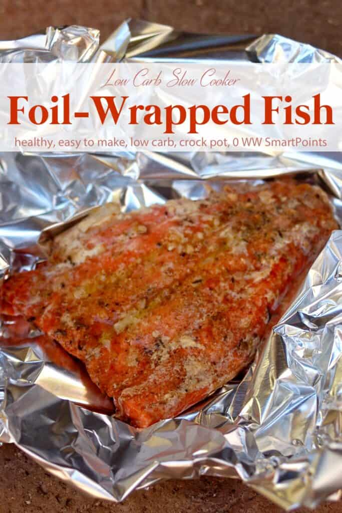 Salmon fillet with seasonings in tin foil.