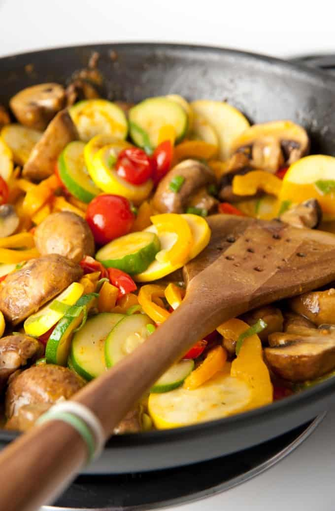 Stovetop skillet with zucchini, tomatoes, mushrooms and yellow squash