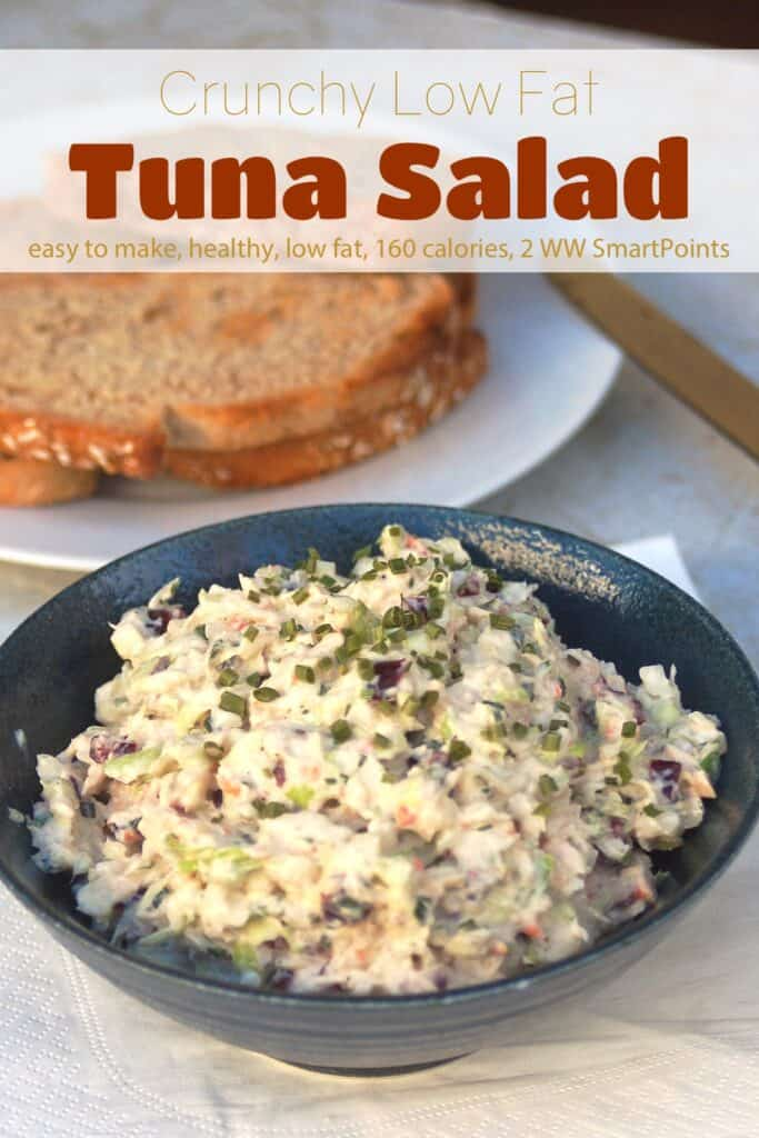 Crunchy tuna salad in blue ceramic bowl near small plate with toast