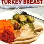 Turkey breast slices with garlic, roasted Brussels sprouts, mashed sweet potatoes and cranberry sauce on white dinner plate with fork.