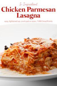 Piece of chicken parmesan lasagna on white plate.