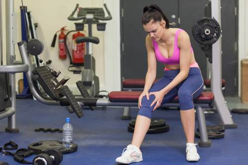 Hurt Woman Working Out in Gym