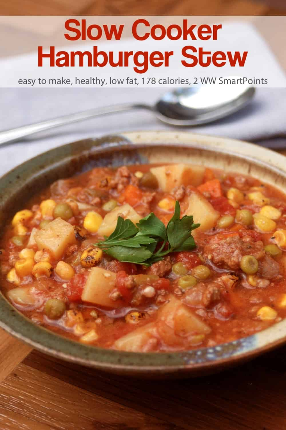This healthy, home cooked slow cooker hamburger stew is a hodgepodge of vegetables and ground beef that simmers for hours in the crock pot - the perfect antidote to weeks of overindulging! #slowcookerhamburgerstew #stew #slowcooker