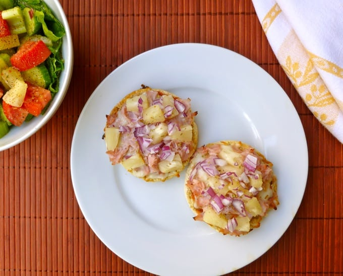 English Muffin Hawaiian Pizza on a white plate from above