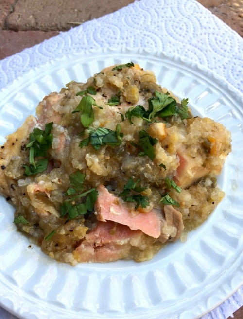 Apricot salsa salmon garnished with fresh cilantro on a white plate