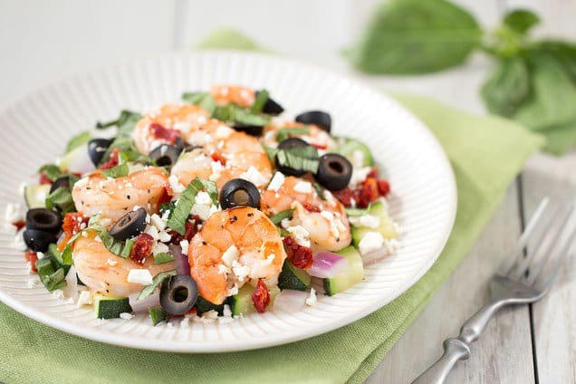 mediterranean shrimp and vegetables on white plate